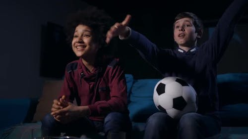 Teen Boys Expecting Goal Watching Football Match