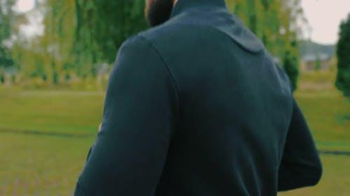 Man Running on the Track