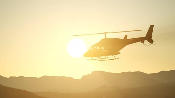Thumbnail for Extreme Slow Motion Flying Helicopter and Sunset Sky