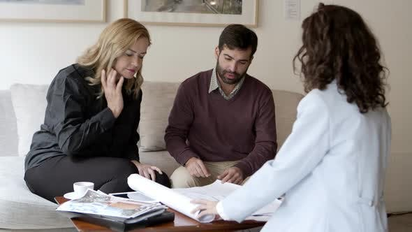 Home Owners Talking with Interior Designer