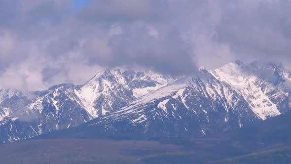 Thumbnail for Panoramic View of the Snow-covered High Tatras. Mountain Peaks in the Clouds