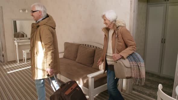 Thumbnail for Delighted Senior Caucasian Couple Moving into Hotel Room