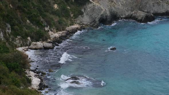 Thumbnail for Coast with Crystal Clear Turquoise Sea Waves Breaking on the Rocks and Cliffs