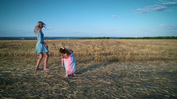 Thumbnail for Mom and Daughter Walk on a Dry Grass Field