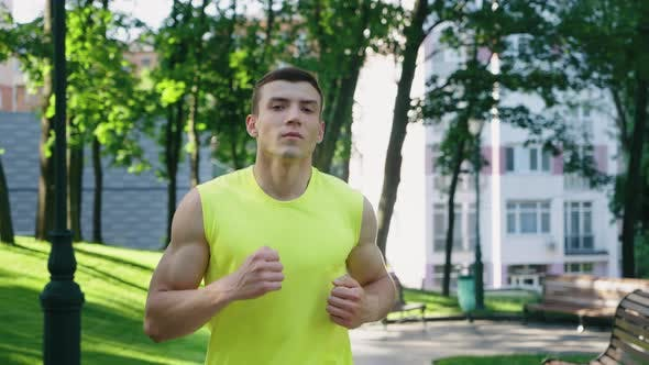 Jogger Exercising in Park in Slow Motion