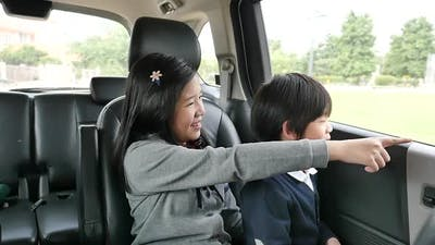 Happy Asian Children Travels By Car