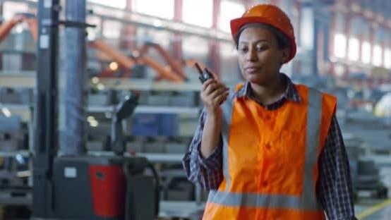 Thumbnail for Black Female Factory Worker Talking on Radio Set