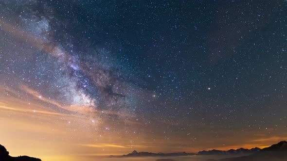 Thumbnail for Time Lapse: the Milky way galaxy and stars rotation over the majestic Italian Alps. Night sky