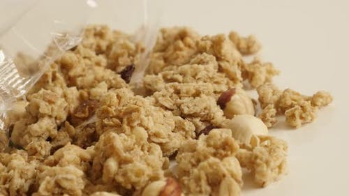 Muesli with  hazelnuts flavor slow pan 4K 2160p 30fps UltraHD footage - High quality cereals heap cl