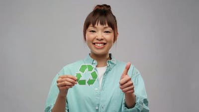 Asian Woman with Recycling Sign Showing Thumbs Up
