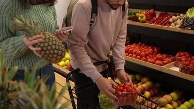 Young Couple Buying Products in Grocery Store