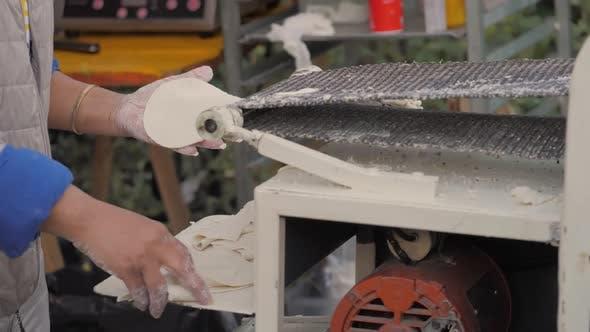 Woman Make Dough in Tortilla Machine in Mexico