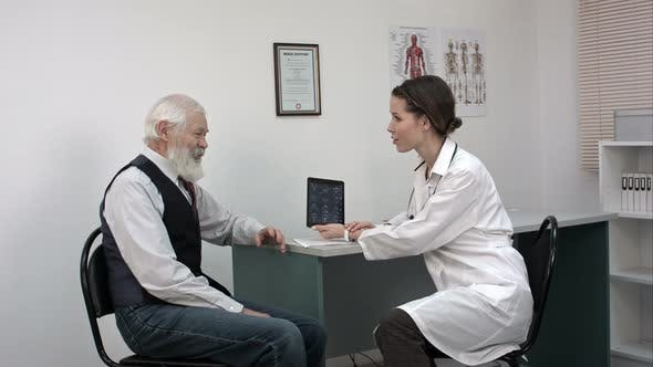Thumbnail for Old Patient Talking To Young Female Doctor