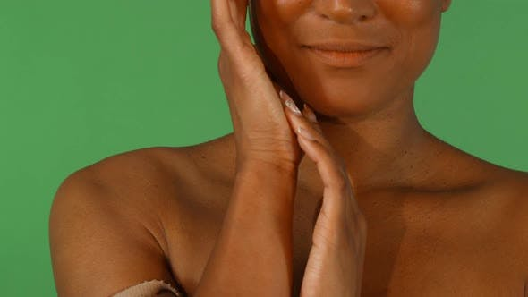 Cover Image for Portrait of a Beautiful African Woman Touching Her Face While Smiling