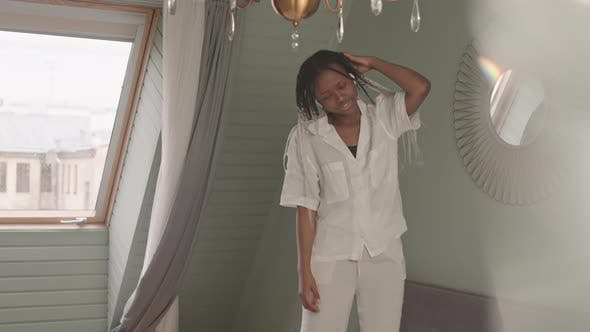African American Woman Enjoying Music at Home