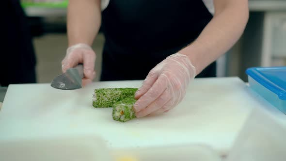 Cook Cuts Japanese Rolls with Dill.