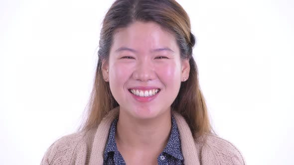 Thumbnail for Face of Happy Young Asian Woman Smiling and Laughing Ready for Winter