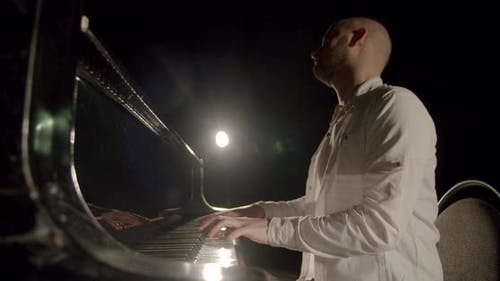 Professional Pianist Plays Gentle Classical Music on a Grand Piano. Slow Motion