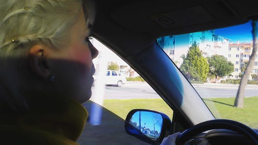 Thumbnail for Woman Driving in the City 2