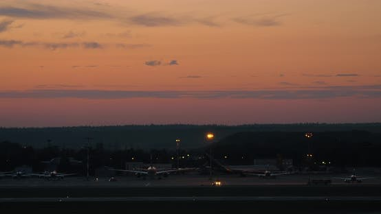Thumbnail for Airport with Plane Taking Off in the Dusk