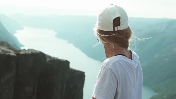 Thumbnail for Tourist Looking Over the Fjords In Between Steep Mountain Range, Norway