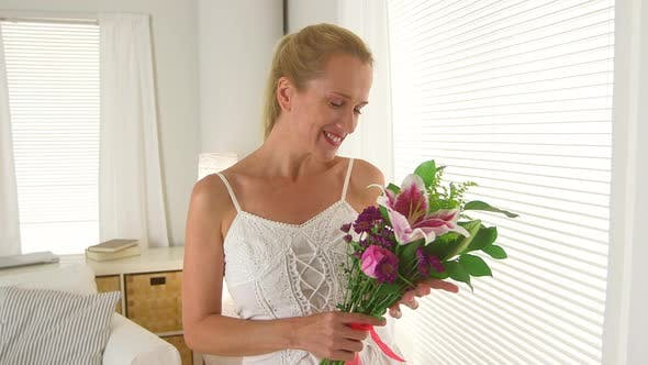 Thumbnail for Middle aged woman with bouquet of flowers