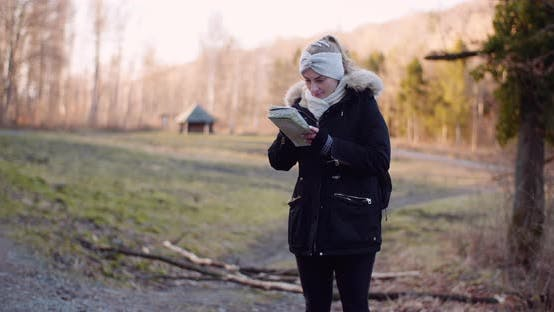 Thumbnail for Tourist Reading Map on Trail in Mountains