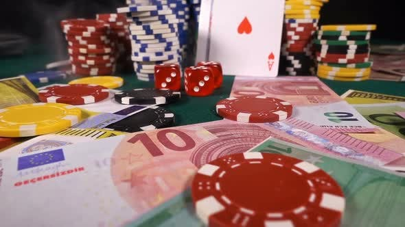 Thumbnail for Gambling Red Dices Poker Cards And Money Chips In Smoke