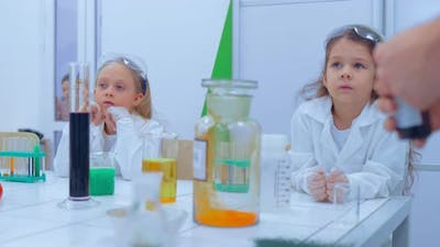 Children Studing Chemistry in School Laboratory
