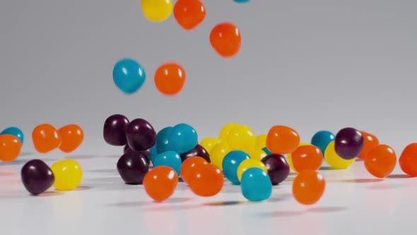 Thumbnail for Colorful candy falls in slow motion