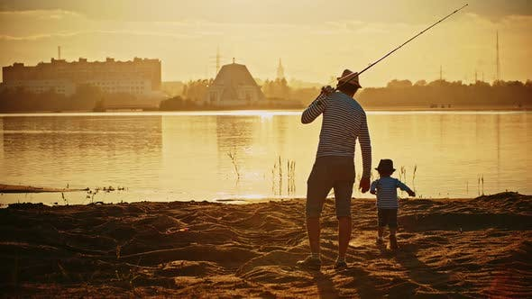 Thumbnail for A Father and His Son on Fishing Together - a Man Holding the Rod and the Happy Boy Walking on the