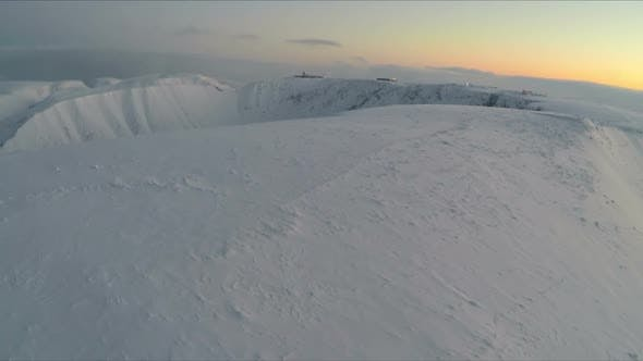 Thumbnail for Fly Over Snow Covered Mountains In The Morning