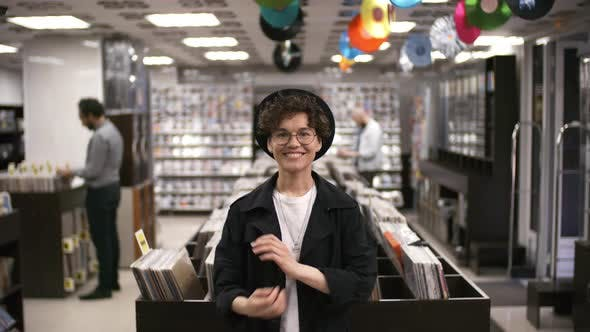 Thumbnail for Hipster Female Record Shop Manager Posing and Smiling