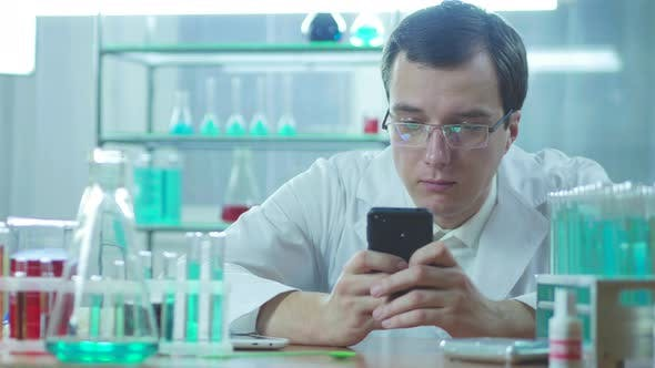 Cover Image for Doctor In Laboratory With Mobile Phone