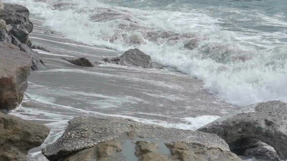 Thumbnail for Foamy Ocean Waves Rolling Over Sandy Coast with Rocks, Power of Nature