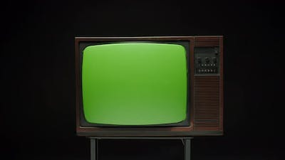 Old Retro Television with Antenna on Grey Background