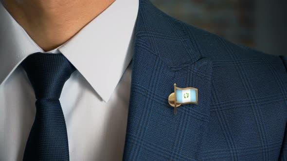 Thumbnail for Businessman Walking Towards Camera With Country Flag Pin Guatemala