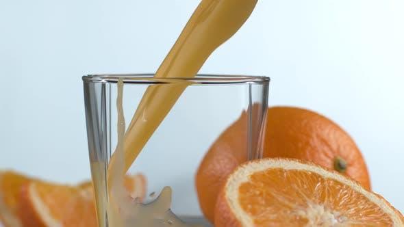 Pouring orange juice in super slow motion.  Shot on Phantom Flex 4K high speed camera.