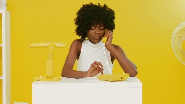 Black Woman Has Phone Talk In Office