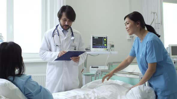 Patient Shaking Hand of Doctor