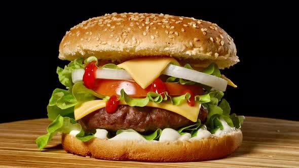 Thumbnail for Great Burger with Beef Cutlet, Tomatoes, Mushrooms and Cucumbers with Melted Cheese Rotates on a