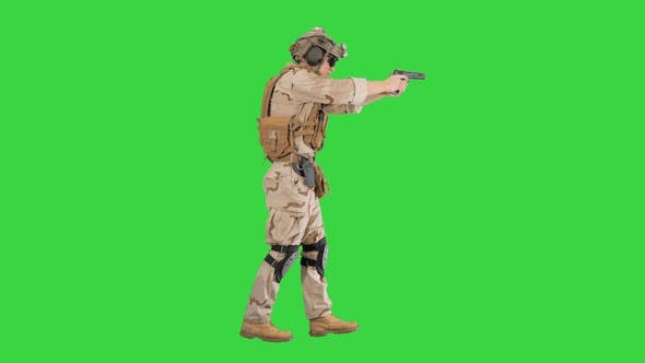 Thumbnail for Marine Walking with Pistol and Shooting on a Green Screen, Chroma Key.