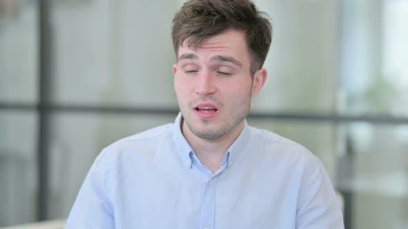 Portrait of Sick Young Man Sneezing