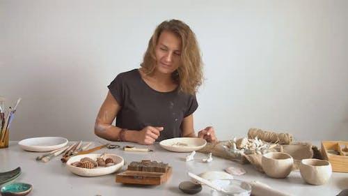 Female Ceramist Working in the Studio