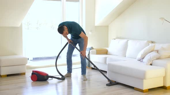 Thumbnail for Man with Vacuum Cleaner at Home