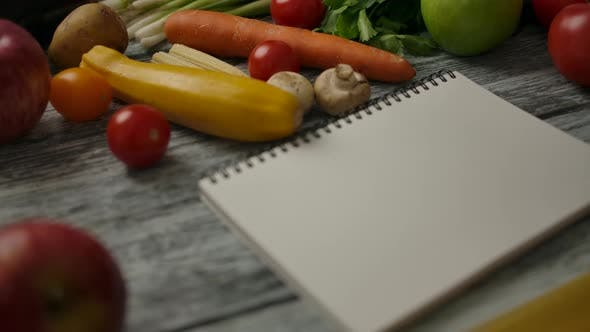 Thumbnail for Blank Notebook Near Cooking Ingredients on Wooden Table