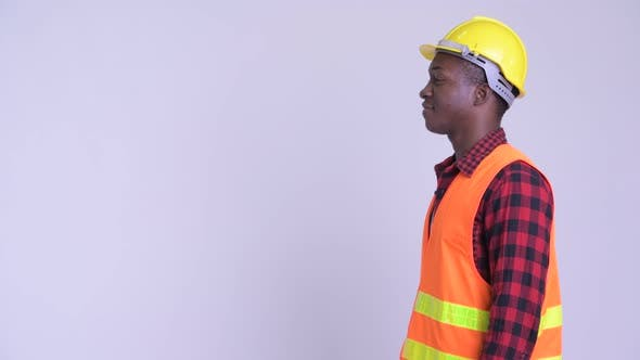 Thumbnail for Profile View of Happy Young African Man Construction Worker Smiling