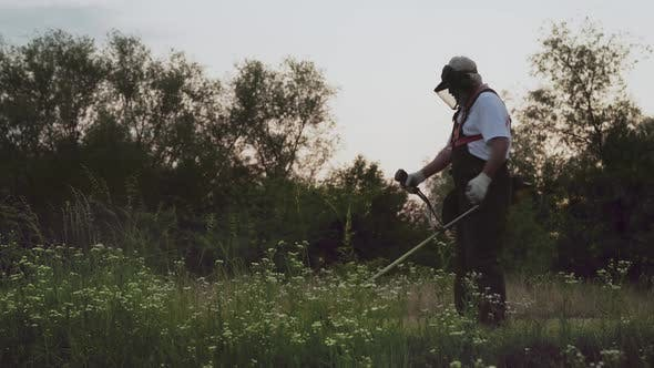 Thumbnail for Man Wearing Protective Mask and Overalls Working in Garden