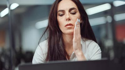 Stressed Business Woman in Office