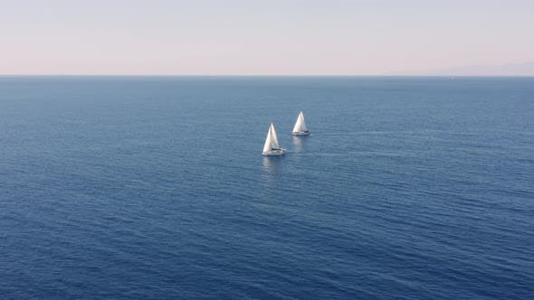 aerial view of sailboats in the open sea